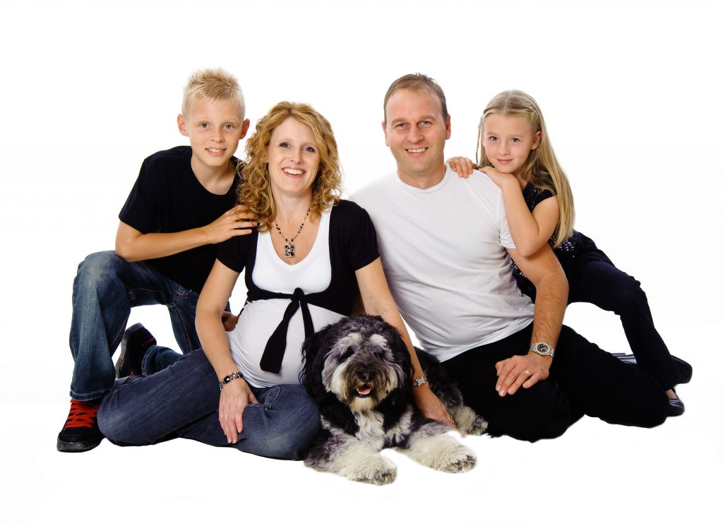 family posing for a family portrait